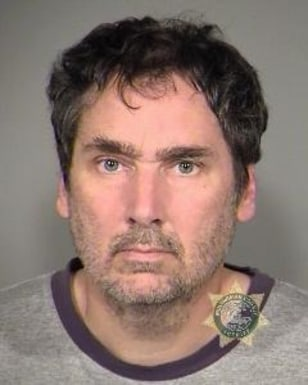 Image: This booking photo from the Multnomah County Sheriff's Office shows Darryl James Swanson, 45