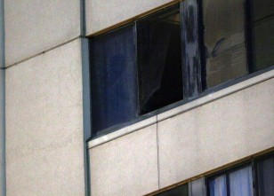 Image: A piece of torn screen is visible in the ninth-floor window of a St. Paul, Minn., building from which a toddler fell to its death