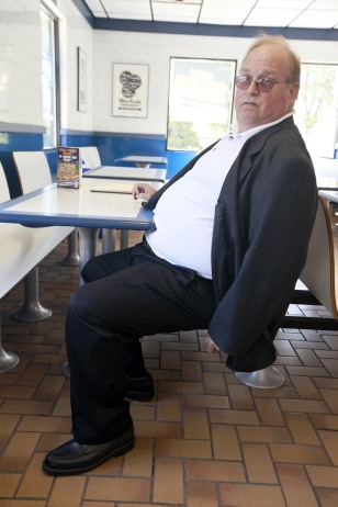 Image: Martin Kessman sitting in restaurant booth