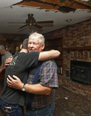Image: Joe Reneau and Cody Parsons embrace amidst earthquake damage in Oklahoma