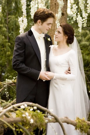 "Image: Robert Pattinson and Kristen Stewart play Edward and Bella on their wedding day in ""Breaking Dawn"" fi"