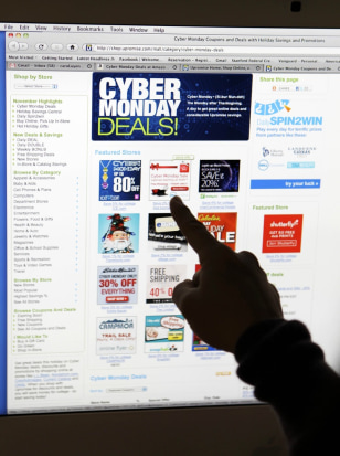 Image: A woman looks at Cyber Monday sales on her computer
