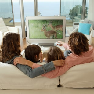 Image: Family in living room watching television