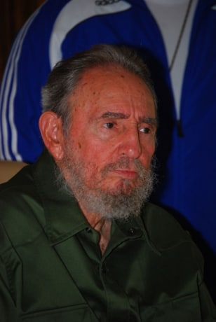 Fidel Castro appears publicly in his green army fatigues.