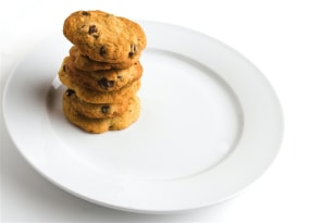 "In a recent experiment, a group of executives was put to the cookie test. When cookies were labeled ""medium,"" the execs ate more than when the same cookies were described as ""large."""