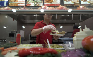 Image: A worker in a fast food restaurant