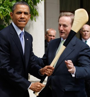 Image: U.S. President Barack Obama jokingly swings a hurling stick given to him by Taoiseach Enda Kenny during his visit to Farmleigh House in Dublin