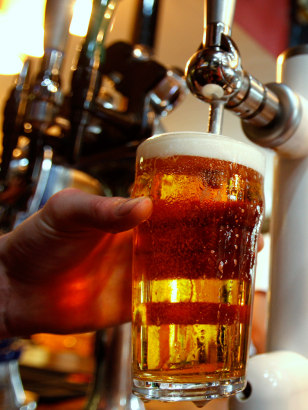 Image: A pint of beer is poured