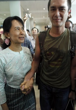 Image: Myanmar's pro-democracy leader Aung San Suu Kyi looks at her son Kim Aris after he arrived at Yangon's airport