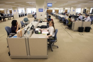Image: Campaign staff work in President Barack Obama's new campaign headquarters in Chicago