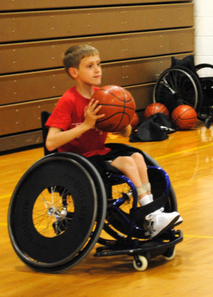 Image: Nolan Turner, who raised money to bring wheelchair basketball to his school