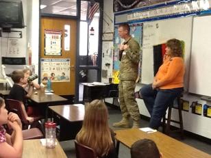 Image: Sgt. Jeremy Flowers visits Debbie Wilsie's third-grade class