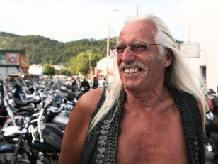 Image: It's common to see gray hair amid the good times at the annual Sturgis Motorcycle Rally in South Dakota.