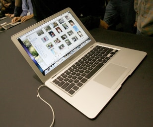 A new MacBook Air ultra thin laptop sits