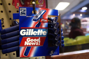 Image: Gillette Good News razors rest on a shelf of a grocery store