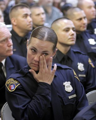 Image: Officer Choat wipes tears during her graduation in Cleveland
