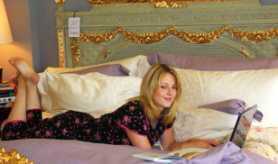 Image: Roisin Madigan on bed with laptop