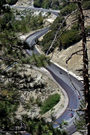 Image: A road winds through Angeles National Forest