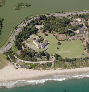 Oceanfront estate with pond behind