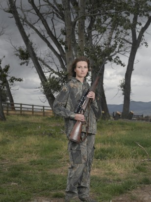 "Image: Jen, a woman pictured with a gun in the book ""Chicks with Guns"""