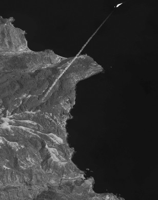This image released by DigitalGlobe shows the contrail and rocket plume of the North Korean Taepodong-2 launch vehicle