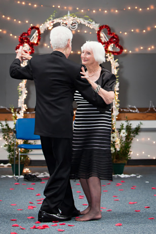 Image: Rose Pollard Lunsway and Forrest Lunsway dance at their wedding reception