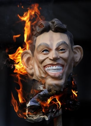 Image: A mask of former British Prime Minister Tony Blair is burned