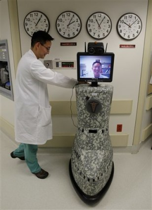 Image: Dr. Kevin Chung with robot