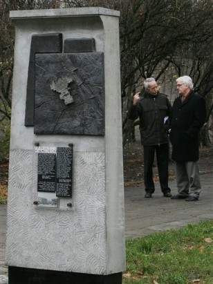 Image: Two men near memorial plaque