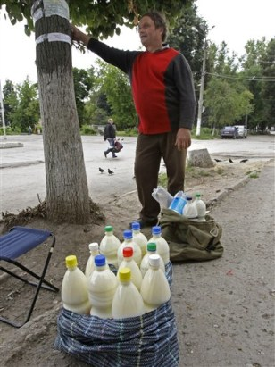 Image: A man sells milk