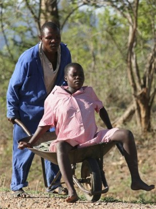 Image: Misheck Bunyira carries his pregnant wife, Janet