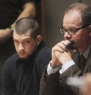 Image: Michael Robie, left, sits with his lawyer James Moir in court in North Haverhill, N.H.