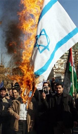 Image: Iranians burn Israeli flag
