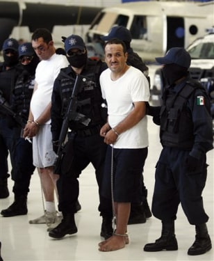 Image: Mexico police with alleged drug cartel members