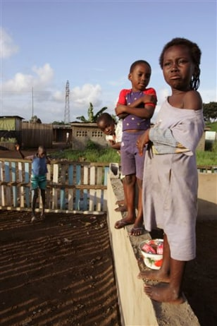 IMAGE: CHILDREN NEAR TOXIC WASTE DUMP