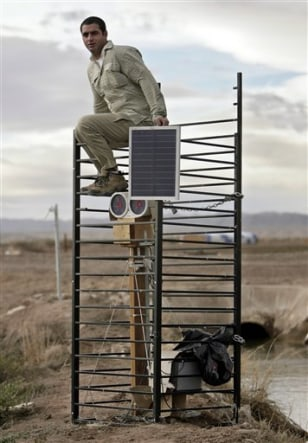 Image:Student atop a scinillometer transmitter