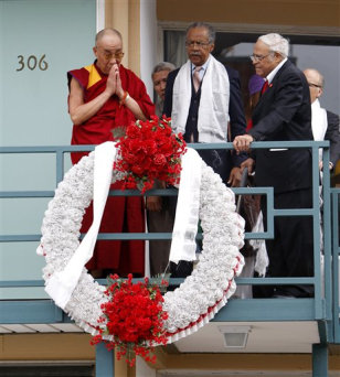 Image: The Dalai Lama, left, prays