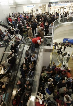 Image: Passengers fill the terminal after a security breach
