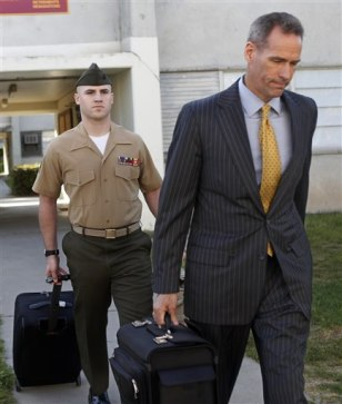 Image: Marine Sgt. Ryan G. Weemer, left, follows his civilian attorney, Paul Hackett