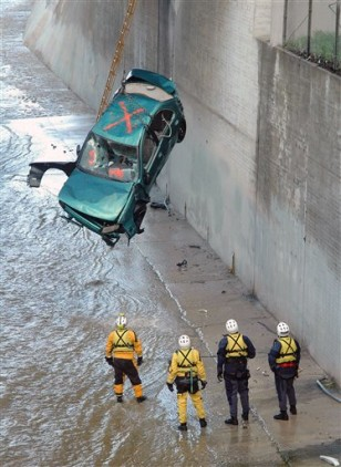 IMAGE: CAR SWEPT INTO RIVER