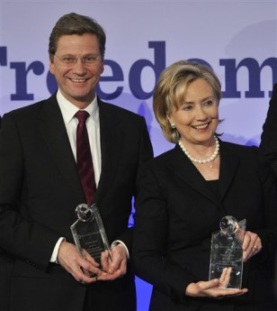 Image: U.S. Secretary of State Hillary Clinton, right, and German Foreign Minister Guido Westerwelle, left