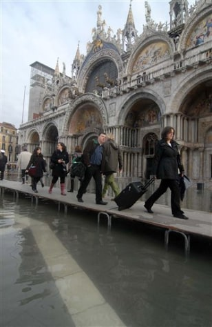 Image: Tourists and residents in Venice