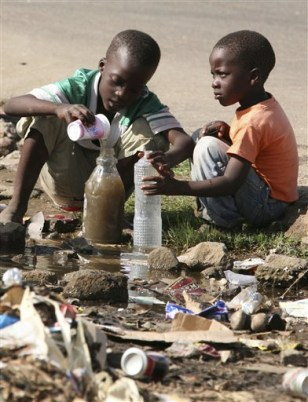 Image: Children collect stagnant water