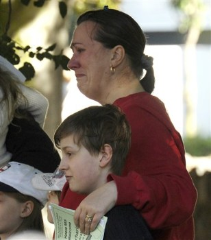 Image: Joanne Fagan-Oslawskyj weeps as she attends a church service at St. Barnabas with her 8-year-old son old Jamie