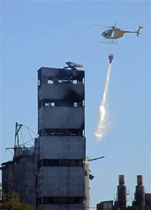 IMAGE: HELICOPTER DROPS WATER