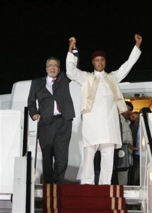 Image: Libyan Abdel Baset al-Megrahi, left, and Seif al-Islam Gadhafi
