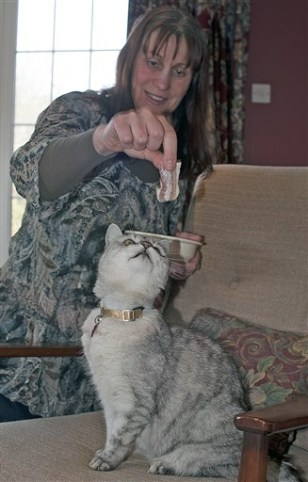 Image: Smokey the cat with owner Ruth Adams
