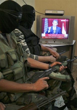 Image: Palestinian militants watching Obama speech