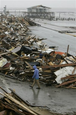 Image: A man walks past debris