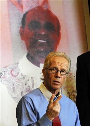 Image: Lawyer with photo of Rev. Jeyapaul